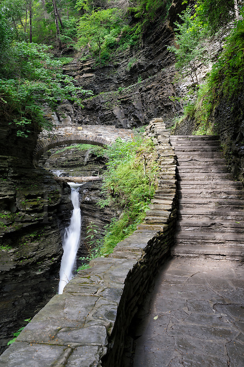 Trail ad staircase leading to stone bridge in a rocky gorge, Watkins Glen, New York, USA.