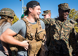 December 21, 2017 - Sevilla, Spain - Comedian and actor Adam Devine meets with Marines assigned to Special Purpose Marine Air-Ground Task Force Crisis Response Africa as part of a troop engagement during the Chairmans USO Holiday Tour at Moon Air Base Dec. 21, 2017. .(Credit Image: