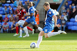 Peterborough United's Grant McCann shoots and scores the second goal - Photo mandatory by-line: Joe Dent/JMP - Tel: Mobile: 07966 386802 05/10/2013 - SPORT - FOOTBALL - London Road Stadium - Peterborough - Peterborough United V Preston North End - Sky Bet League 1