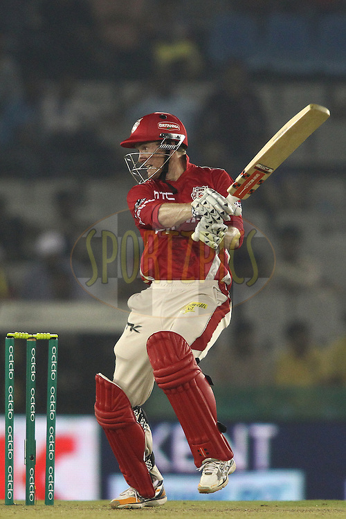 Kings XI Punjab captain George Bailey square cuts a delivery during match 2 of the Oppo Champions League Twenty20 between the Kings XI Punjab and the Hobart Hurricanes held at the Punjab Cricket Association Stadium, Mohali, India on the 18th September 2014<br /> <br /> Photo by:  Shaun Roy / Sportzpics/ CLT20<br /> <br /> <br /> Image use is subject to the terms and conditions as laid out by the BCCI/ CLT20.  The terms and conditions can be downloaded here:<br /> <br /> http://sportzpics.photoshelter.com/gallery/CLT20-Image-Terms-and-Conditions-2014/G0000IfNJn535VPU/C0000QhhKadWcjYs