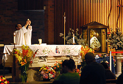 "United States, Illinois, Chicago, September 25, 2009. Since 1623, the revered figure of ""Nuestra Senora de los Lagos,"" or ""Our Lady of San Juan de los Lagos"" in Jalisco, Mexico has provided comfort and miracles for those who believe. Sometimes known as ""The Traveling Virgin,"" for seven days she graced the Church of the Good Shepherd in Little Village, and hundreds of Catholics came from miles around to pay their respects."