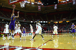 29 December 2011:  Seth Tuttle slips underneath Jackie Carmichael for a lay up during an NCAA mens basketball game between the Northern Illinois Panthers and the Illinois State Redbirds in Redbird Arena, Normal IL