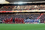 Liverpool and Brighton and Hove Albion players take part in the minutes appreciation during the Premier League match between Liverpool and Brighton and Hove Albion at Anfield, Liverpool, England on 30 November 2019.