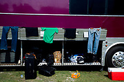 Clothes and suitcases in a tour bus. Vans Warped Tour, USA touring punk rock music festival, Bicentennial park, Miami, Florida, USA. 24th June 2006