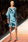 An aqua blue satin dress with deep draped neck and loose, bare-shoulder sleeves.