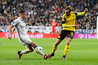 Real Madrid's Lucas Vazquez and Borussia Dortmund Marcel Schmelzer during the UEFA Champions League match between Real Madrid and Borussia Dortmund at Santiago Bernabeu Stadium in Madrid, Spain. December 07, 2016. (ALTERPHOTOS/BorjaB.Hojas)