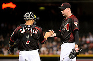 PHOENIX, AZ - MAY 28:  Brad Ziegler #29 of the Arizona Diamondbacks is congratulated by Welington Castillo #7 after closing out the game against the San Diego Padres at Chase Field on May 28, 2016 in Phoenix, Arizona. The Arizona Diamondbacks won 8-7. (Photo by Jennifer Stewart/Getty Images)