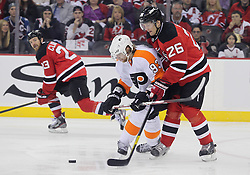 May 6, 2012; Newark, NJ, USA; Philadelphia Flyers right wing Jakub Voracek (93) and New Jersey Devils center Patrik Elias (26) battle for the puck during the first period in game four of the 2012 Eastern Conference semifinals at the Prudential Center.