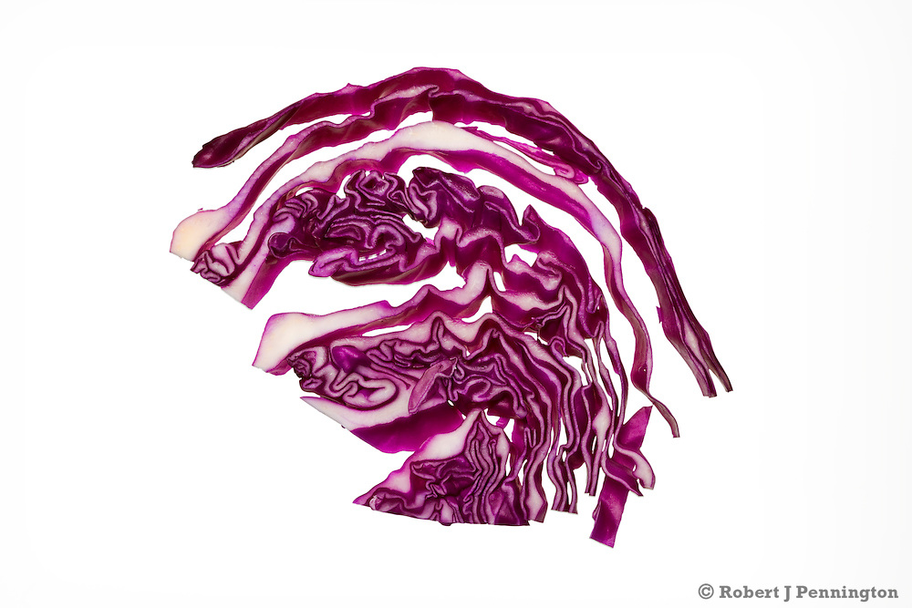 Strands of red cabbage on a white background