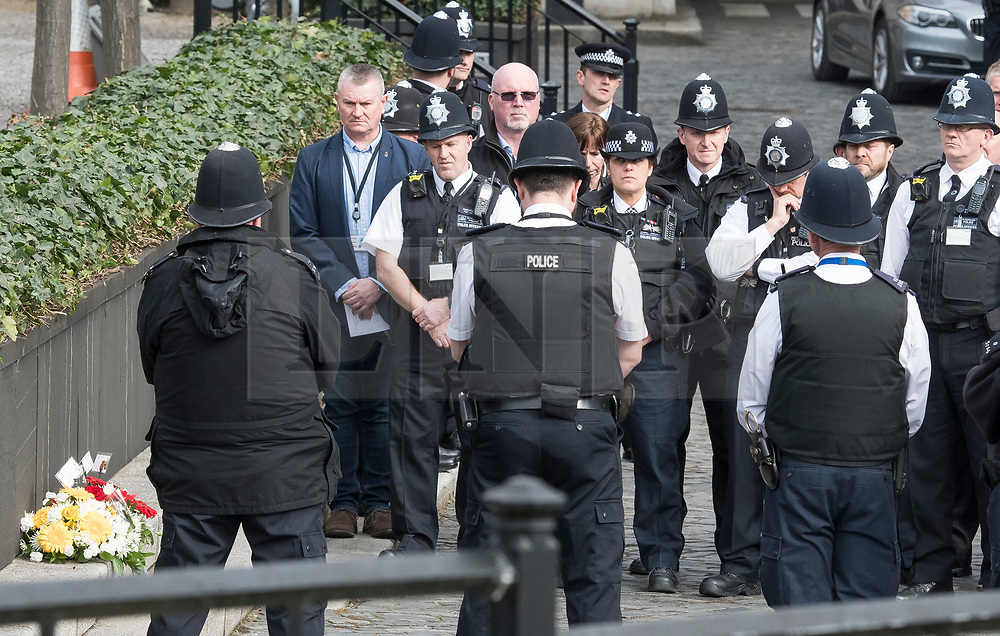 © Licensed to London News Pictures. 22/03/2018. London, UK. Members of the Police Force hold a minutes silence at New Palace Yard, inside the grounds of the Houses of Parliament in Westminster, London at the time PC Palmer died, on the one year anniversary of the Westminster Bridge Terror attack. A lone terrorist killed 5 people and injured several more, in an attack using a car and a knife. The attacker, 52-year-old Briton Khalid Masood, managed to gain entry to the grounds of the Houses of Parliament and killed police officer Keith Palmer. Photo credit: Ben Cawthra/LNP