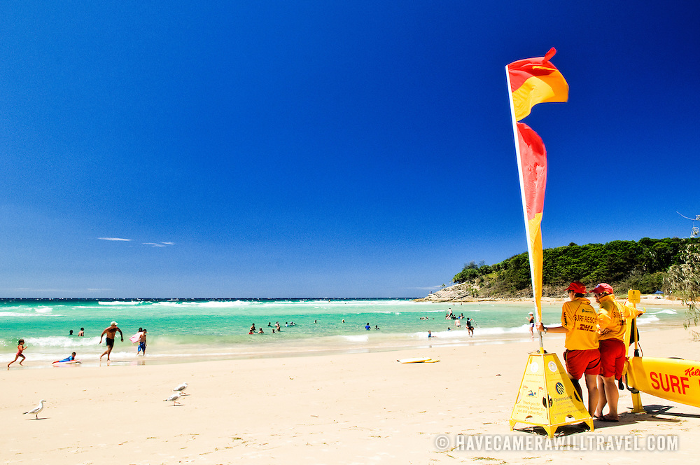 Lifesavers on duty at Cylinder Beach on Stradbroke Island, Queensland. The beach was named such because it used to be the landing point for offloading the gas cylinders for the nearby lighthouse on Point Lookout. North Stradbroke Island, just off Queensland's capital city of Brisbane, is the world's second largest sand island and, with its miles of sandy beaches, a popular summer holiday destination.