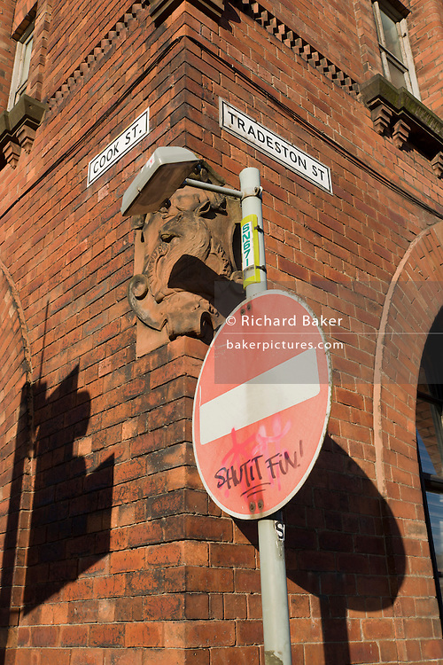 A No Entry sign and red brick building on the corner of Cook and Tradeston streets in the Goven Hill district of south Glasgow.