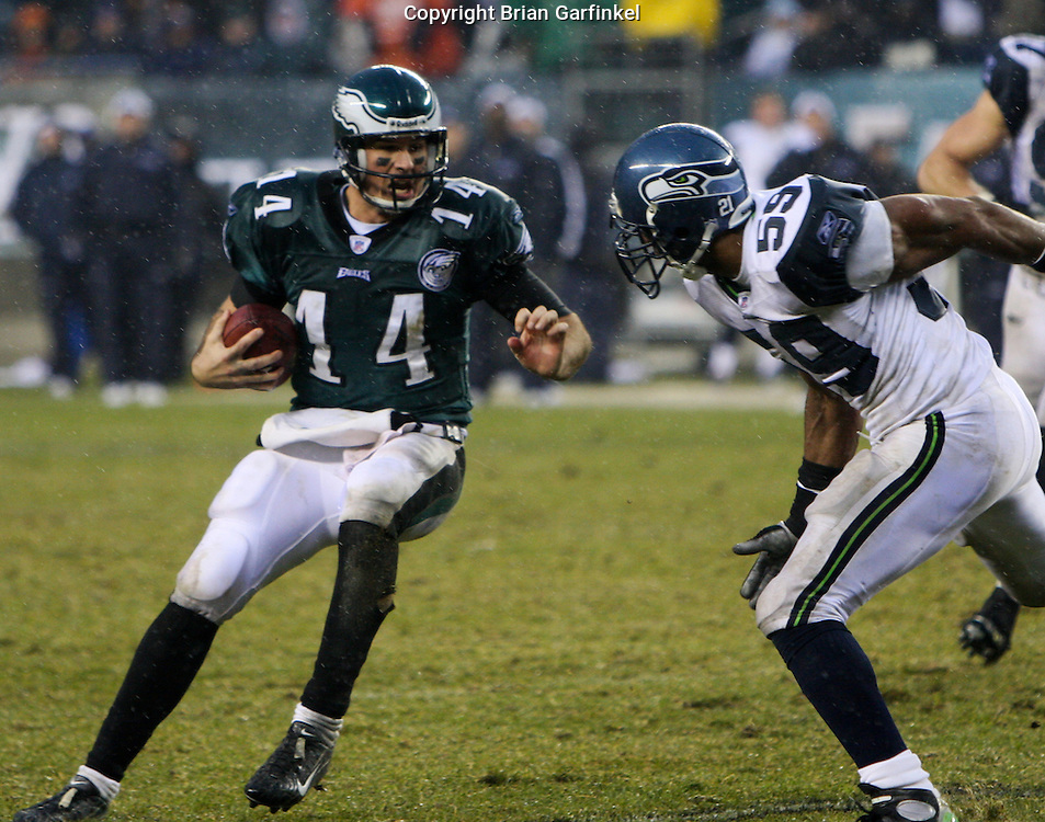 PHILADELPHIA - DECEMBER 2: Quarterback A.J. Feeley of the Philadelphia Eagles avoids Darrell Tapp of the Seahawks during the game against the Seattle Seahawks at Lincoln Financial Field December 2, 2007 in Philadelphia, Pennsylvania. The Seahawks won 28-24.