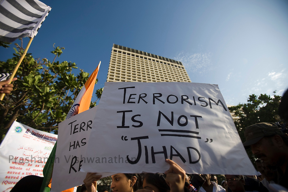 Indian Muslims hold placards during a peace rally to condemn the recent attacks by gunmen in Mumbai, December 7, 2008. India accuses the banned Islamist movement Laskhar-e-Taiba of training and equipping the 10 militants who stormed India's financial capital by boat to kill 188 people and leaving more than 300 others injured during the 60-hour orgy of violence that saw two luxury hotels and a number of other sites targeted.