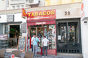people in front of Tobacco store, Madrid, Spain