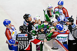 Scott Hotham (HDD Tilia Olimpija, #5) and Jamie Fraser (HDD Tilia Olimpija, #44) vs Pascal Morency (KHL Medvescak Zagreb, #44) and Vyacheslav Trukhno (KHL Medvescak Zagreb, #11) during ice-hockey match between HDD Tilia Olimpija and KHL Medvescak Zagreb in 30th Round of EBEL league, on December 9, 2011 at Hala Tivoli, Ljubljana, Slovenia. KHL Medvescak Zagreb defeated HDD Tilia Olimpija 5:3. (Photo By Matic Klansek Velej / Sportida)