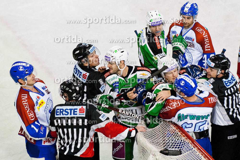 Scott Hotham (HDD Tilia Olimpija, #5) and Jamie Fraser (HDD Tilia Olimpija, #44) vs Pascal Morency (KHL Medvescak Zagreb, #44) and Vyacheslav Trukhno (KHL Medvescak Zagreb, #11) during ice-hockey match between HDD Tilia Olimpija and KHL Medvescak Zagreb in 30th Round of EBEL league, on December 9, 2011 at Hala Tivoli, Ljubljana, Slovenia. KHL Medvescak Zagreb defeated HDD Tilia Olimpija 5:3. (Photo By Matic Klansek Velej / Sportida)