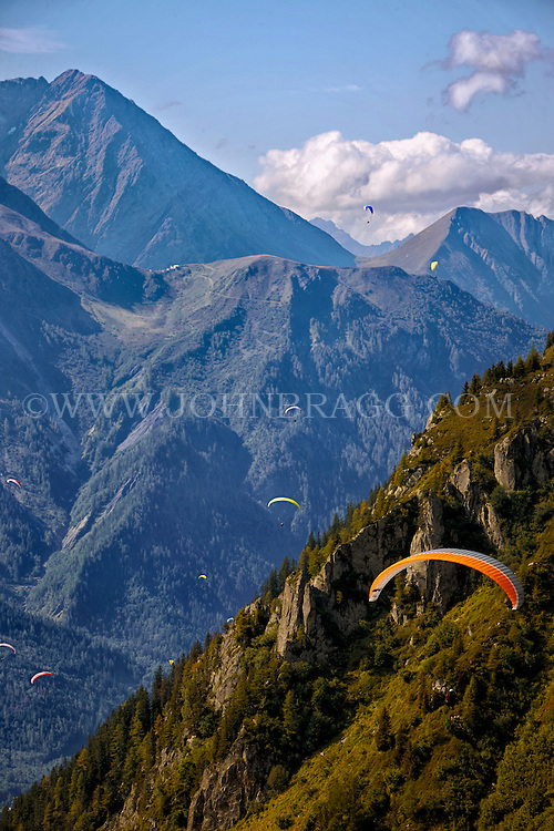 Paragliding from La Flégère overlooking the French Alps with Mont Blanc in the background - Chamonix, France (Vertical)