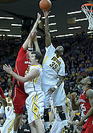 January 26, 2012: Iowa Hawkeyes forward Devon Archie (35) blocks a shot by Nebraska Cornhuskers center Jorge Brian Diaz (21) as Iowa Hawkeyes forward Zach McCabe (15) defends during the NCAA basketball game between the Nebraska Cornhuskers and the Iowa Hawkeyes at Carver-Hawkeye Arena in Iowa City, Iowa on Thursday, January 26, 2012.