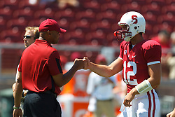 September 3, 2011; Stanford, CA, USA;  Stanford Cardinal quarterback Andrew Luck (right) fist bumps head coach David Shaw (left) during warmups before the game against the San Jose State Spartans at Stanford Stadium.
