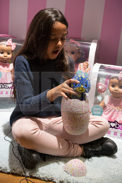 © Licensed to London News Pictures. 08/11/2017. London, UK. A young girl plays with Hatchimals Surprise is part of the Dream Toys top twelve toys for Christmas 2017. Photo credit: Ray Tang/LNP