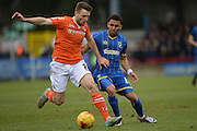 Luton Town defender Stephen O'Donnell  and Andy Barcham of AFC Wimbledon during the Sky Bet League 2 match between AFC Wimbledon and Luton Town at the Cherry Red Records Stadium, Kingston, England on 13 February 2016. Photo by David Vokes.