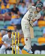 "Chris Rogers keeps the ball down late on Day 2 of the 1st Test in the 2013-14 Ashes Cricket Series between Australia and England at the GABBA (Brisbane, Australia) from Thursday 21st November 2013<br /> <br /> Conditions of Use : NO AGENTS ~ This image is subject to copyright and use conditions stipulated by Cricket Australia.  This image is intended for Editorial use only (news or commentary, print or electronic) - Required Image Credit : ""Steven Hight - AURA Images"""
