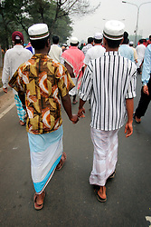 BANGLADESH TONGI 4FEB07 - Muslim boys hold hands on their way to the gathering during the last day of the BiswaIjtema outside Tongi, a northern suburb of the capital city Dhaka. The annual Tablighi Jamaat Islamic movement congregation lasts three days and is attended by over two million Muslims, making it the second largest congregation after the Hajj to Mecca. Devotees from approximately 80 countries, including the host country, Bangladesh, attend the three-day Ijtema seeking divine blessings from Allah. The event focuses on prayers and meditation and does not allow political discussion. The local police estimated the number of attendees of the 2007 Ijtema to be 3 million...jre/Photo by Jiri Rezac..© Jiri Rezac 2007..Contact: +44 (0) 7050 110 417.Mobile:  +44 (0) 7801 337 683.Office:  +44 (0) 20 8968 9635..Email:   jiri@jirirezac.com.Web:    www.jirirezac.com..© All images Jiri Rezac 2007 - All rights reserved.