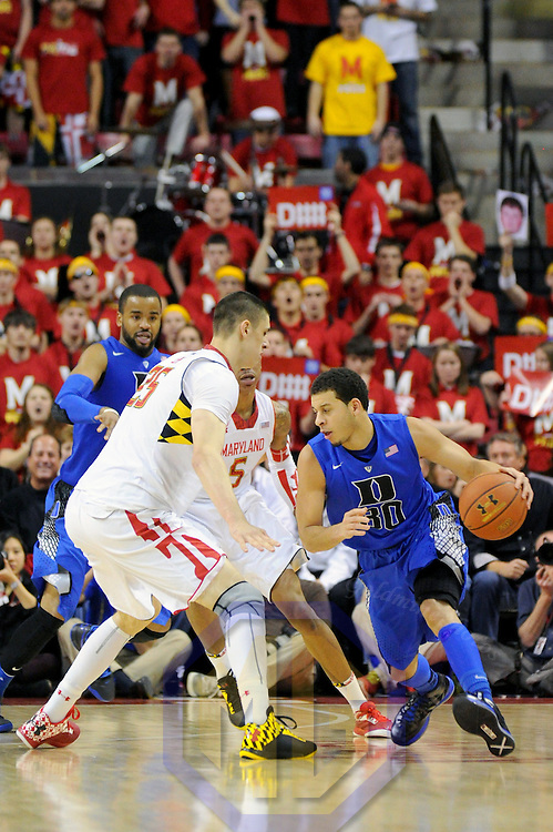 16 February 2013:   Duke Blue Devils guard Seth Curry (30) in action against Maryland Terrapins center Alex Len (25) at the Comcast Center in College Park, MD. where the Maryland Terrapins upset the second ranked Duke Blue Devils, 83-81.