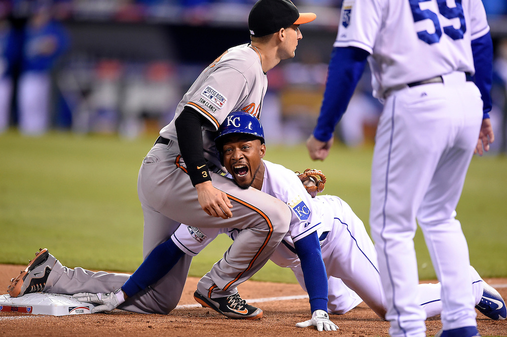 Kansas City Royals center fielder Jarrod Dyson ended up in the lap of Baltimore Orioles third baseman Ryan Flaherty after he made it safely back to third base on a pickoff attempt in the seventh inning in the American League Championship Series playoff baseball game on October 14, 2014 at Kauffman Stadium in Kansas City, MO.