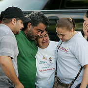 Jose Cortez (left) Miguel Cortez, Maria Cortez (mother-middle), Juani Cortez, and Lucy Cortez cried after Javier Cortez was killed in his southeast Houston home early today after several intruders bound him and his mother with duct tape and ransacked the house, police said. ( Leonardo Carrizo / Chronicle )
