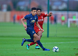 KIRKBY, ENGLAND - Saturday, January 26, 2019: Manchester United's Mason Greenwood and Liverpool's Yasser Larouci during the FA Premier League match between Liverpool FC and Manchester United FC at The Academy. (Pic by David Rawcliffe/Propaganda)