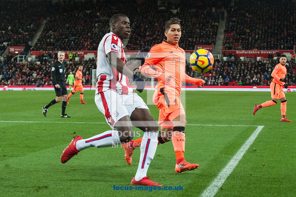 Kurt Zouma of Stoke City with a clearance ahead of Roberto Firmino of Liverpool during the Premier League match at the Bet 365 Stadium, Stoke-on-Trent<br /> Picture by Matt Wilkinson/Focus Images Ltd 07814 960751<br /> 29/11/2017