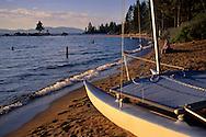Catamaran on sand beach on the shore of Lake Tahoe, at Zephyr Cove, Nevada