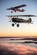 Curtiss-Wright Robin flown by Scott Glover, Curtis Wright Travel Air 4000 flown by Kelly Mahon, O-1 Bird Dog photo ship flown by Matt Bongers, Mount Pleasant, Texas for the Mid America Flight Museum