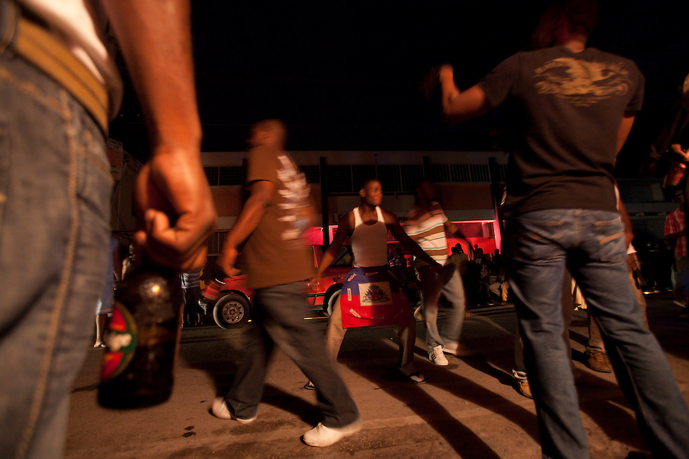 Party in the street of  Port-au-Prince, Haiti on July 24, 2010. <br /> Six month after a catastrophic earthquake measuring 7.3 on the Richter scale hit Haiti on January 13, 2010, killing an estimated 230,000 people, injuring an estimated 300,000 and making homeless an estimated 1,000,000.