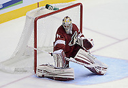 Apr. 6, 2013; Glendale, AZ, USA;  Phoenix Coyotes goalie Mike Smith (41) blocks the puck in the first period while playing in the game against the Colorado Avalanche at Jobing.com Arena. Mandatory Credit: Jennifer Stewart-USA TODAY Sports