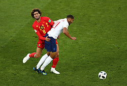England's Ruben Loftus-Cheek (right) is fouled by Belgium's Marouane Fellaini during the FIFA World Cup Group G match at Kaliningrad Stadium.