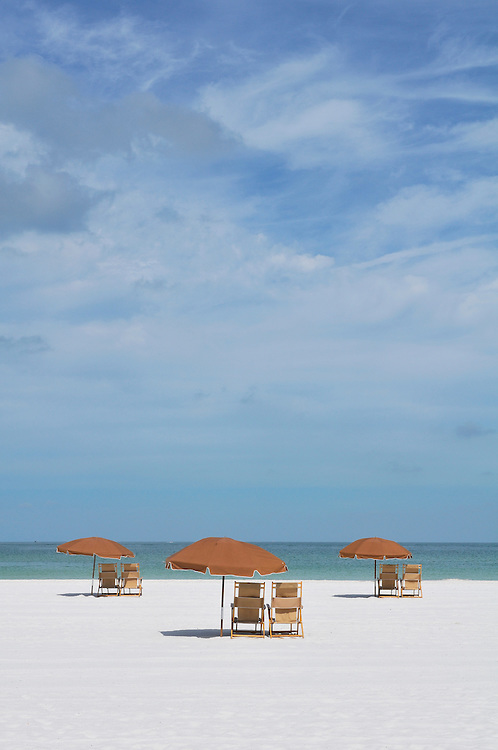 Sun Umbrellas and Beach Chairs on white sand Beach at Sand Pearl Hotel, Clearwater Beach, Florida, USA