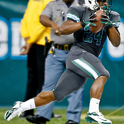Aug 29, 2013; New Orleans, LA, USA; Tulane Green Wave running back Dante Butler (24) breaks away on a run during the first half of a game against the Jackson State Tigers at the Mercedes-Benz Superdome. Mandatory Credit: Derick E. Hingle-USA TODAY Sports