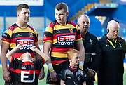 Carmarthen Quins' flanker Ed Siggery is worshipped by a Junior player!<br /> <br /> Cardiff Arms Park, Cardiff, Wales, UK - Saturday 19th October, 2019.<br /> <br /> Images from the Indigo Welsh Premiership rugby match between Cardiff RFC and Carmarthen Quins RFC. <br /> <br /> Photographer Dan Minto<br /> <br /> mail@danmintophotography.com <br /> www.danmintophotography.com