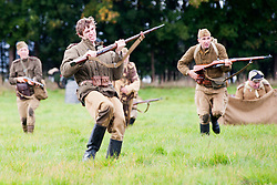 "Re-enactors portray Soviet soldiers from the Russian 13th Guards Rifle Division ""Poltavaskaya"" take part in a battle reenactment Battle reenactment on day two at the Showground Pickering<br />
