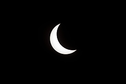 """A partial eclipse on Florida's Space Coast, the rare astronomical event was photographed from the top of the Vehicle Assembly Building, as the Moon passed between Earth and the midafternoon Sun. The Moon's shadow moved across the landscape from Oregon to South Carolina. The 70-mile-wide totality path, or """"umbral cone"""" -- where the entire Sun will vanish behind the Moon -- stretched across 14 states, from Oregon to South Carolina.  Photo credit: NASA/Kim Shiflett<br />   Please note: Fees charged by the agency are for the agency's services only, and do not, nor are they intended to, convey to the user any ownership of Copyright or License in the material. The agency does not claim any ownership including but not limited to Copyright or License in the attached material. By publishing this material you expressly agree to indemnify and to hold the agency and its directors, shareholders and employees harmless from any loss, claims, damages, demands, expenses (including legal fees), or any causes of action or allegation against the agency arising out of or connected in any way with publication of the material."""