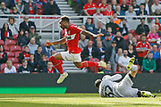 Middlesbrough forward Britt Assombalonga (9) hurdles Stoke City goalkeeper Adam Federici (32)  during the EFL Sky Bet Championship match between Middlesbrough and Stoke City at the Riverside Stadium, Middlesbrough, England on 19 April 2019.