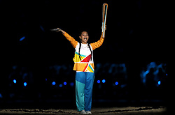 A torchbearer during the Opening Ceremony for the 2018 Commonwealth Games at the Carrara Stadium in the Gold Coast, Australia.