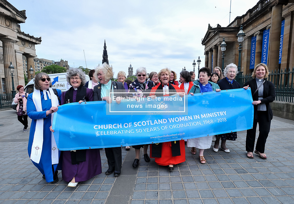Pictured: Women ministers and supporters march up the Mound to the General Assembly, led by former Moderator the Reverend Lorna Hood.<br /> <br /> Women ministers and supporters processed up the Mound in Edinburgh to the General Assembly of the Church of Scotland to mark 50 years since the Church allowed the ordination of women.<br /> <br /> © Dave Johnston / EEm