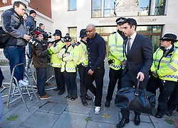 © London News Pictures. 19/12/2013 . MIKE GLC (real name Michael Coombs, pictured centre) leaving Westminster Magistrates court on London where he faced charges of supplying a class A drug. Mike GLC and Former X-Factor judge Tulisa Contostavlos are accused of supplying a class A drug to an investigative journalist. Photo credit : Ben Cawthra/LNP