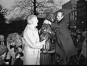 "Molly Malone Statue Unveiled. (R93)..1988..20.12.1988..12.20.1988..20th December 1988..""Dublin's Fair City"" received a millenniun gift to commemorate her most famous daughter, Molly Malone, when Jurys Hotel Group plc presented a specially commissioned sculpture to the people of Dublin. The sculpture was formally handed over by Michael McCarthy, MD,Jurys Hotel Group, to the Lord Mayor of Dublin, Councillor Ben Briscoe, TD, in an unveiling ceremony today at the corner of Grafton Street, Suffolk Street and Nassau Street..Molly Malone was created and fashioned in her traditional 17th century dress by Dublin born artist, Jeanne Rynhart, who was selected from a number of entries for the statue design, by the Dublin Millennium Board...Image shows Lord Mayor, Ben Briscoe giving Molly a hug as Michael McCarthy of Jurys Hotel looks on."