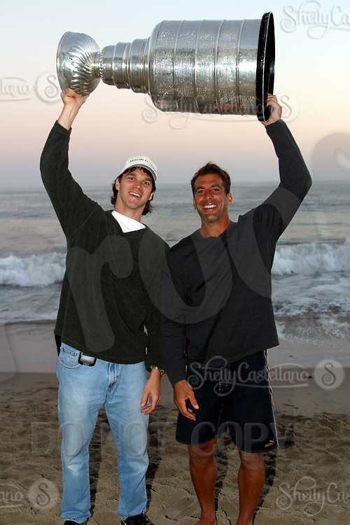 Aug 24, 2002; Malibu, CA, USA; Detroit Red Wings professional hockey players and friends CHRIS CHELIOS &amp; LUC ROBITAILLE hold the NHL Stanley Cup over their head at sunset on the beach at the Pacific Ocean infront of Chris's summer home in Los Angeles. <br />