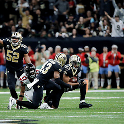 Dec 24, 2017; New Orleans, LA, USA; New Orleans Saints outside linebacker Craig Robertson (52) reacts after cornerback Marshon Lattimore (23) intercepts a pass against the Atlanta Falcons during the second quarter at the Mercedes-Benz Superdome. Mandatory Credit: Derick E. Hingle-USA TODAY Sports